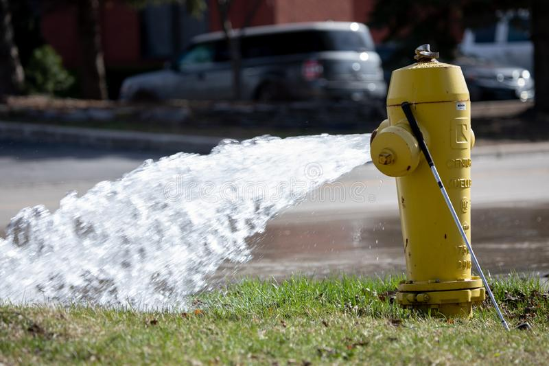 Fire Safety Hydrant Maintenance Open Water Flow Street Gushing. Onto the road royalty free stock images