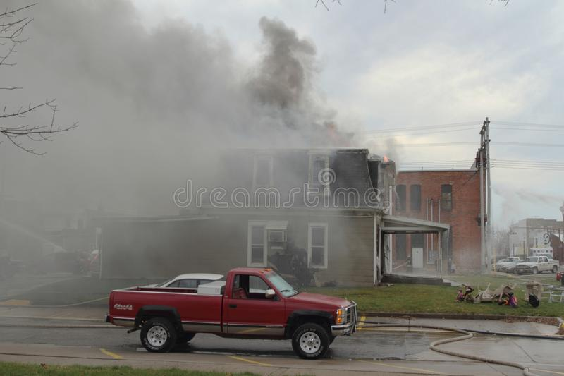 Fire scene with smoke and cloudy sky royalty free stock photo