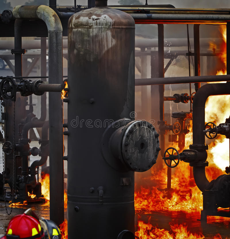 Fire School Training with live fire and fireman royalty free stock images
