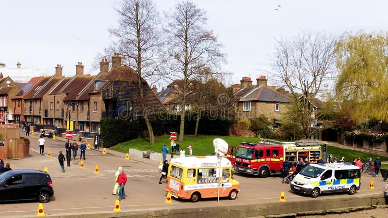 An event day by the river thames in Twickenham London. The fire service and police service where there for a local radio station fair by the thames riverside royalty free stock photos