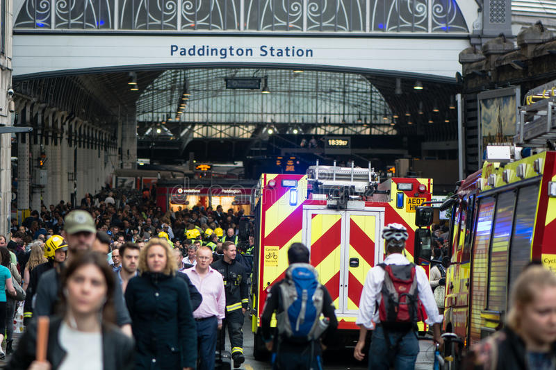 Fire services attend incident outside Paddington Station. LONDON, UK - JUNE 16 2016 Emergency services respond to derailed train at peak commuter time at one of stock photos