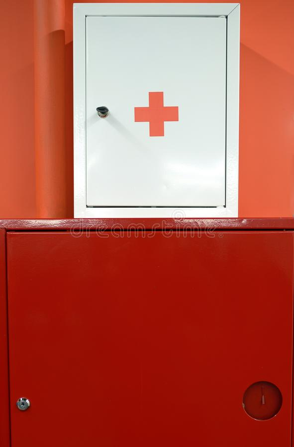 Fire shield and first aid box on the wall.  stock photos