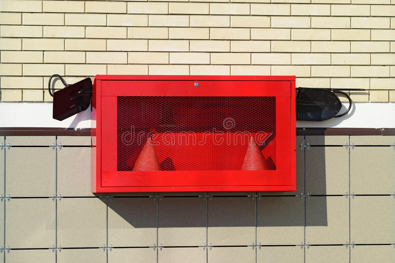 Fire Shield on the wall. Set primary fire extinguishing equipment stock photography