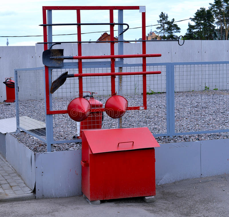 Fire Shield on the wall. Set primary fire extinguishing equipme. Nt stock photo
