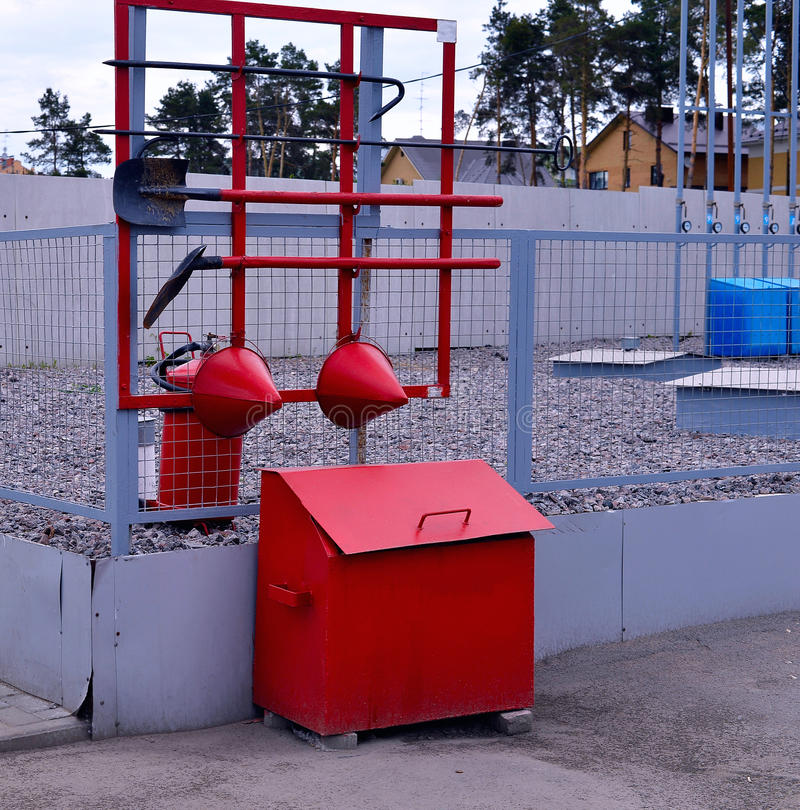Fire Shield on the wall. Set primary fire extinguishing equipme. Nt stock image