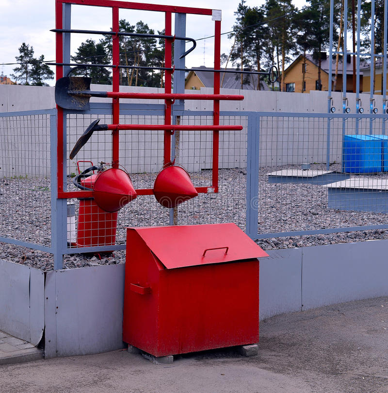 Fire Shield on the wall. Set primary fire extinguishing equipme. Nt stock photos