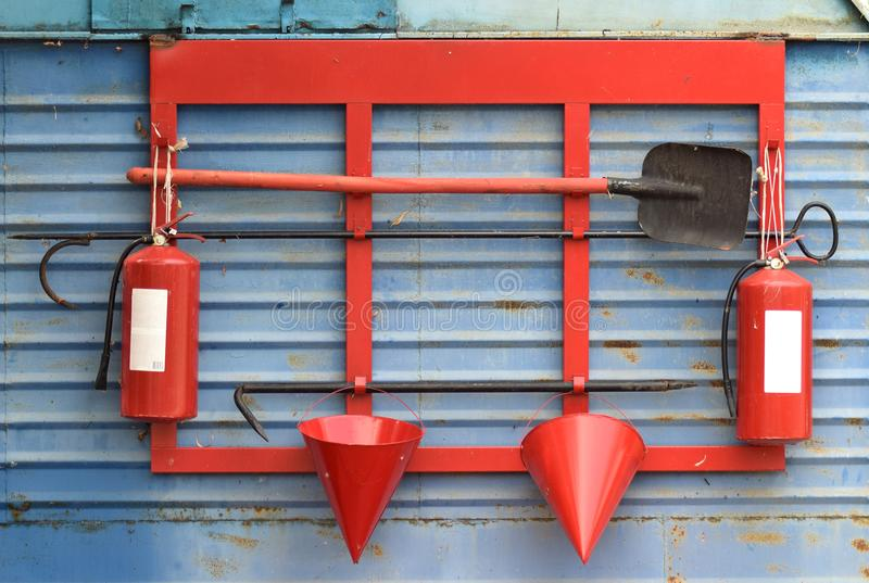 Fire Shield on the wall. Set primary fire extinguishing equipment stock photos