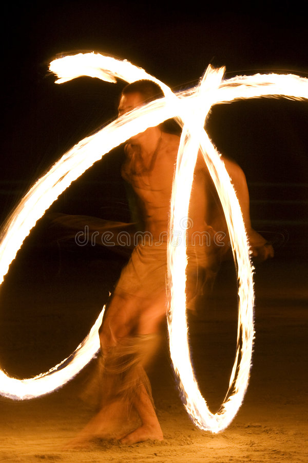 Fire show. Fire-show, young man in action with fire on the beach royalty free stock photos