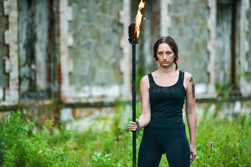 Fire show girl with flaming torches. Girl with flaming torches Fire show 2 royalty free stock photos