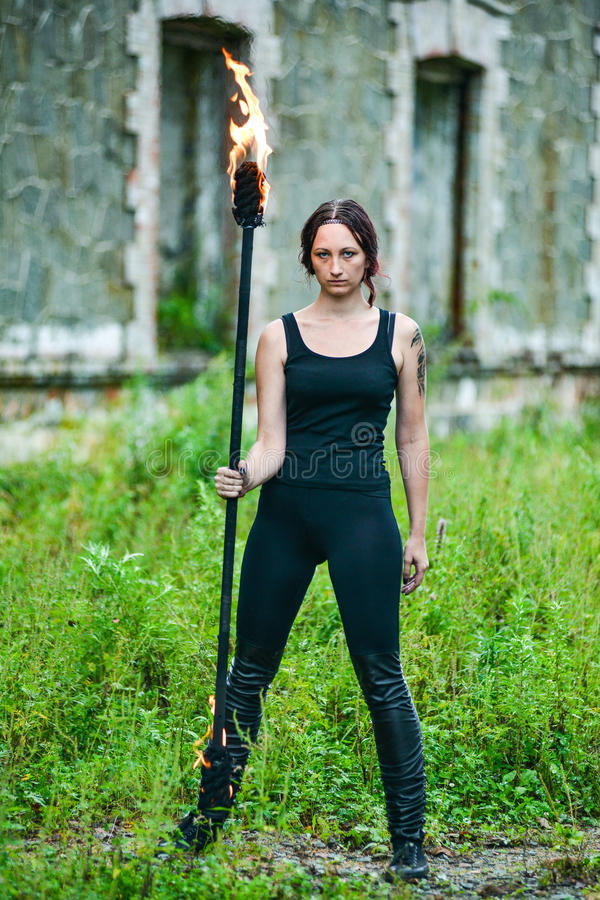 Fire show girl with flaming torches. Girl with flaming torches Fire show 2 royalty free stock images