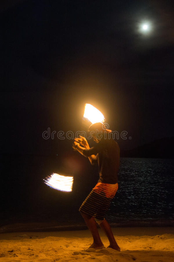 Fire show. FIre juggler performing fire show. Picture taken on Perhentian Kecil island, Malaysia stock image