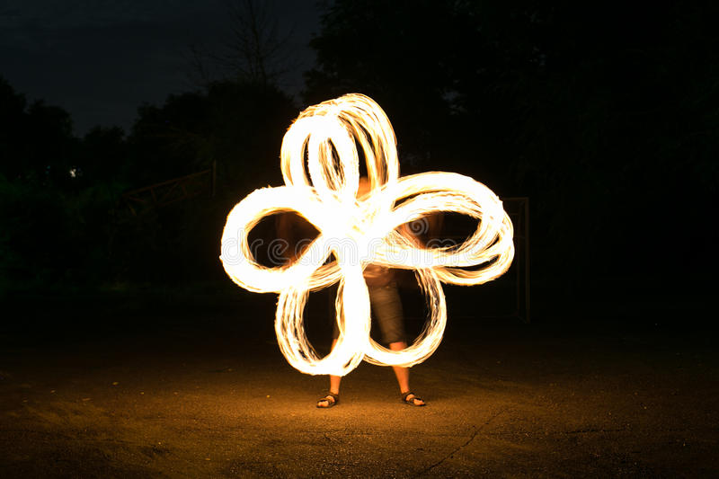 Fire-show man in action. In night time stock photography
