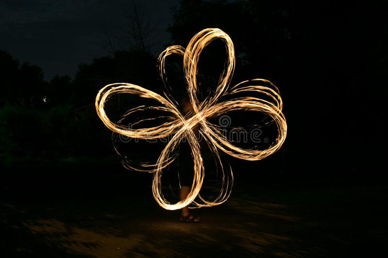 Fire-show man in action. In night time stock photos