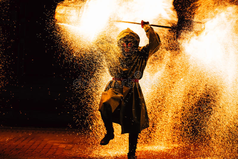 Fire Show At Night. Young Men Stands In Front Of An Audience stock photos