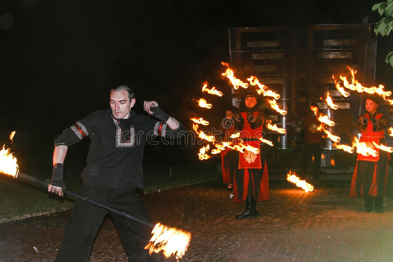 The fire show performed by Belarusian folk ensemble. stock photo