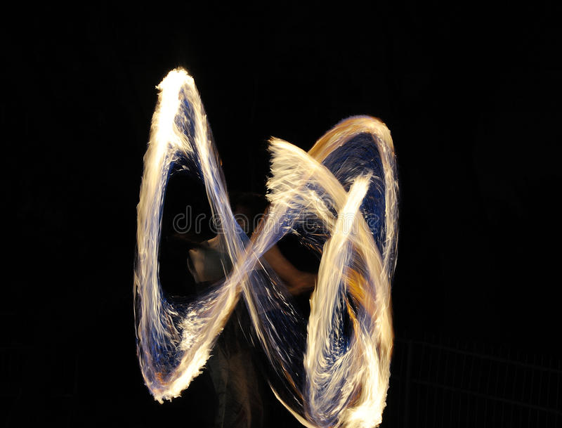 Fire show. Fire tracks on a long exposure during the fire show stock images