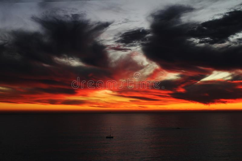 The Fire Sky of the Cape. The beauty of Cape Town is unique, simply having a BRAAI with friends, having a great time and having a mind blowing sunset. What more royalty free stock photos