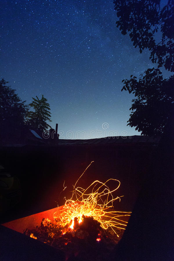 Fire and sky. Fire sparks and sky full of stars at night stock photography