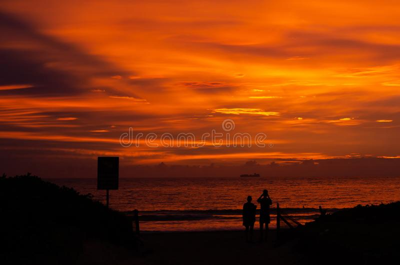 FIRE IN THE SKY 01. A spectacular sunrise at Durban`s South Beach lights up the sky in surreal colours royalty free stock images