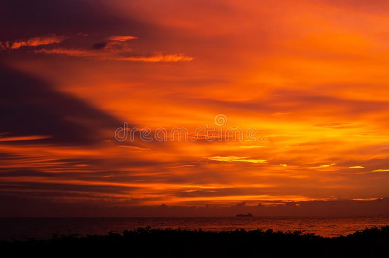 FIRE IN THE SKY 03. A spectacular sunrise at Durban`s South Beach lights up the sky in surreal colours stock photography