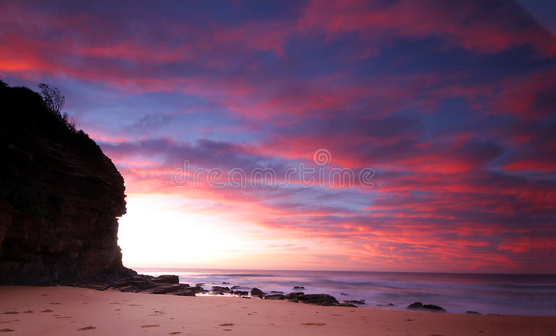 Fire in the sky at sunrise. Clouds at sunrise look like fire in the sky with beautiful reflections in the ocean stock photography