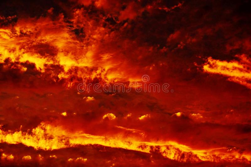Fire in the Sky. Sunset that sets the clouds in the sky on fire royalty free stock image