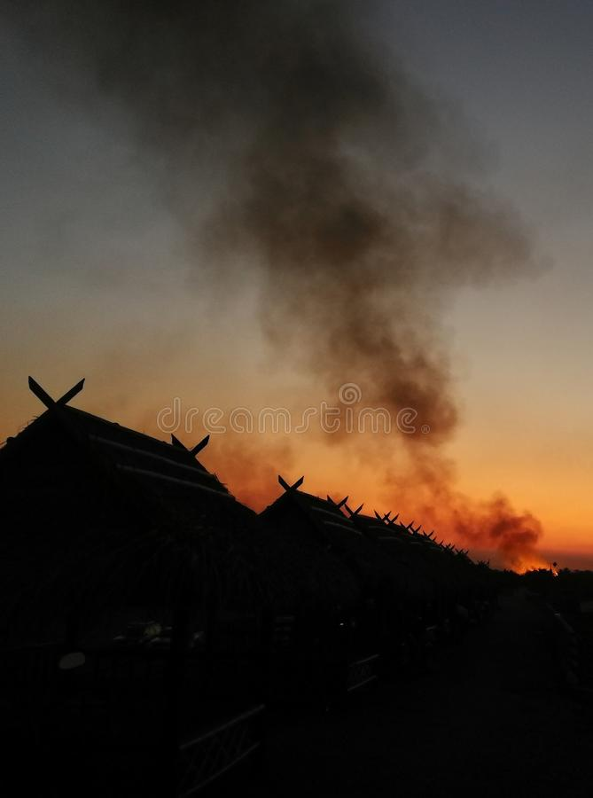 On fire Smoke. Building in fire at the night burning fire flame with smoke on the apartment house roof stock photo