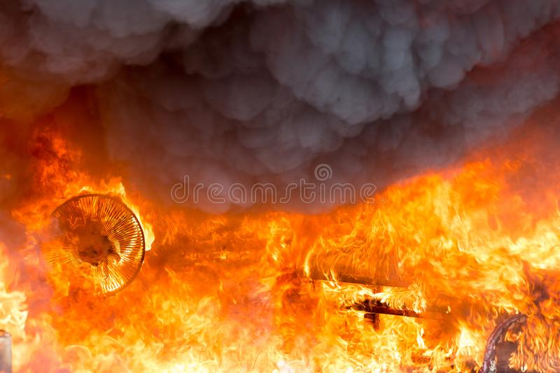 Fire and smoke from furniture burning in conflagration stock image