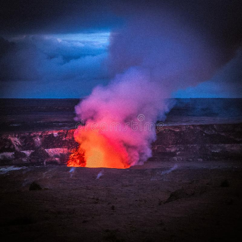Fire and smoke lava volcano night fire hot. Hawaii, United States - September 07, 2012 : Fire and smoke is coming out of the active volcano on the big island of stock images