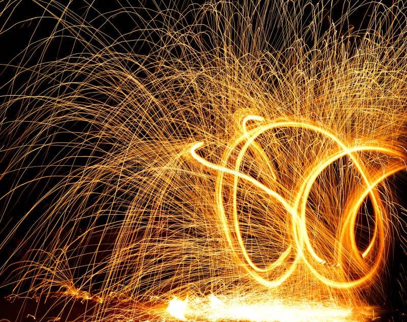 Fire sparkler on black background royalty free stock images