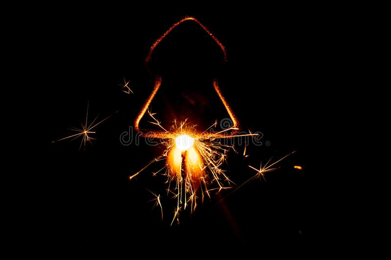 Fire sparklers on black background - Image royalty free stock photos