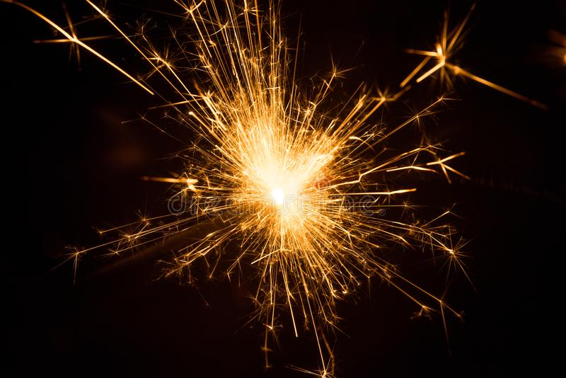 Fire Sparkles With Black Background royalty free stock photos