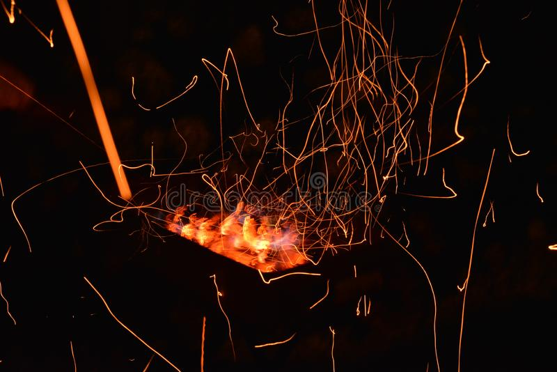 Fire and sparkles  in fireplace. royalty free stock photo