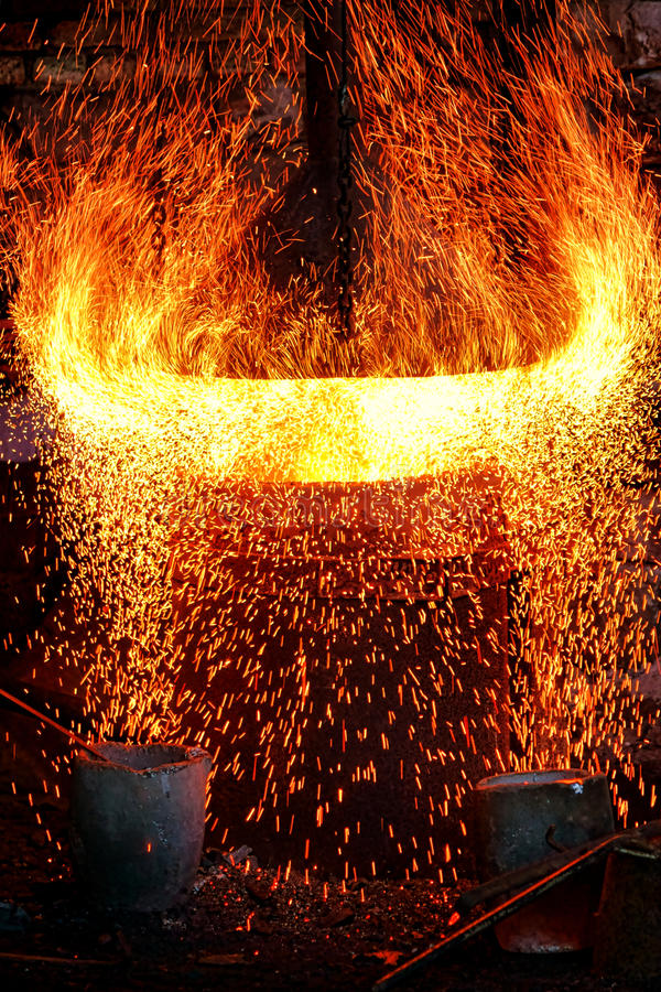 Fire Sparks and Blazing Flames in Blast Furnace stock photos