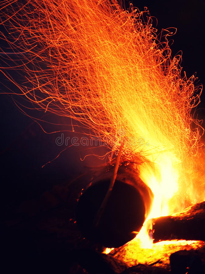 Fire. Sparks  heat night  wood log burning ardor flying sparks coals royalty free stock photography