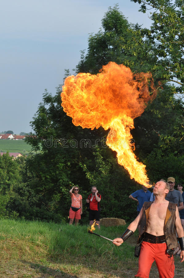 Fire spitting juggler. Fire spitting Artist and juggler of Artist Group Gauler Biberach, see at royalty free stock photo