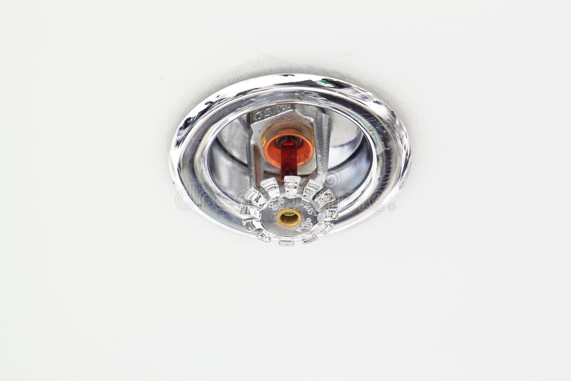 Fire sprinkler. Head on the ceiling stock photo