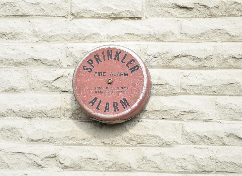 Fire Sprinkler Alarm When Bell Rings Call Fire Department. A fire sprinkler alarm is tied into a fire sprinkler system it is designed to alert occupants of a royalty free stock images
