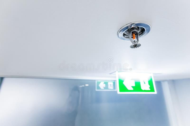 Fire Sprinkler Fireplace in the office for safety and to reduce. Damage in case of fire, signage exit blur background stock photography