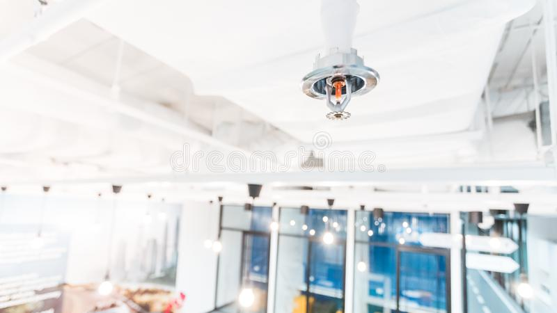 Fire Sprinkler in office building blur background., focus at selective stock images