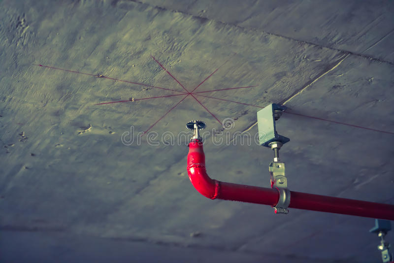 Fire sprinkler and red pipe ( Filtered image processed vintage. Effect stock images