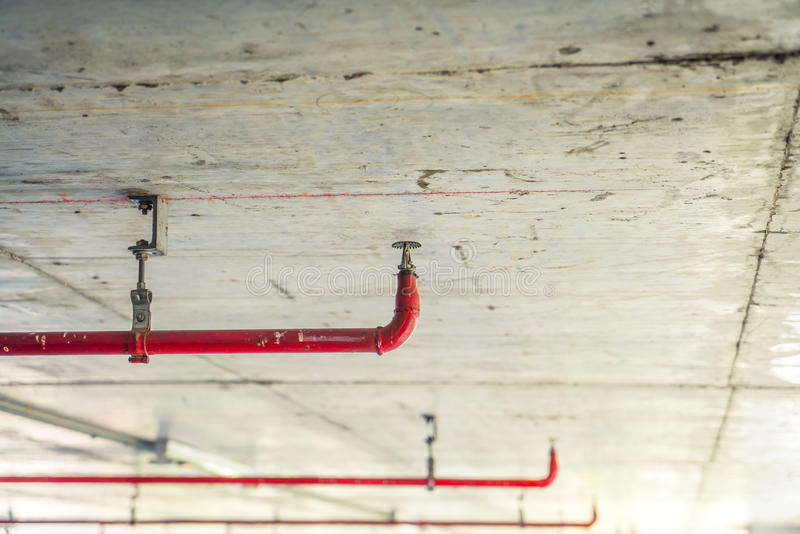 Fire sprinkler and red pipe ( Filtered image processed vintage. Effect royalty free stock image