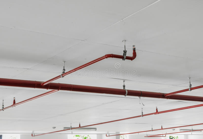 Fire sprinkler with red pipe lines stock photography