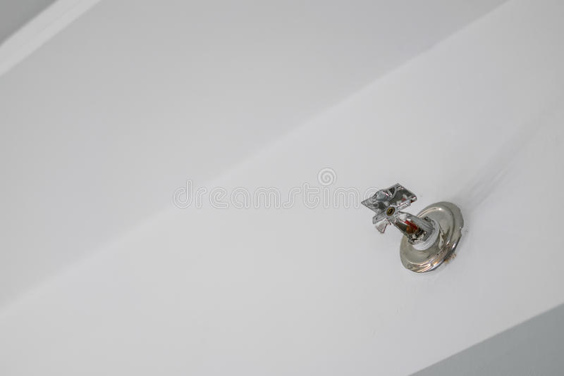 Fire Sprinkler Spraying in hotel room . Fire Sprinkler Spraying in hotel room stock images