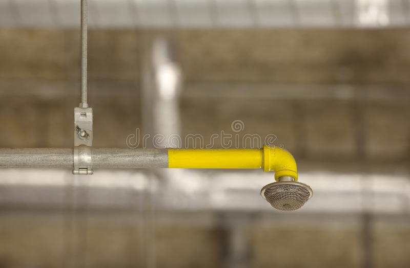 Fire sprinkler. System on concrete ceiling in the building stock images