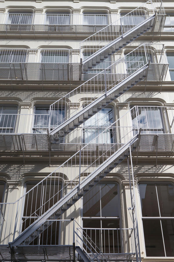 The fire stairs on old house, New York. The typical old houses with fire stairs in New York stock photography