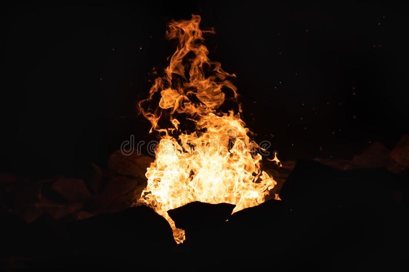 Fire in a Stone Firepit at Night stock image