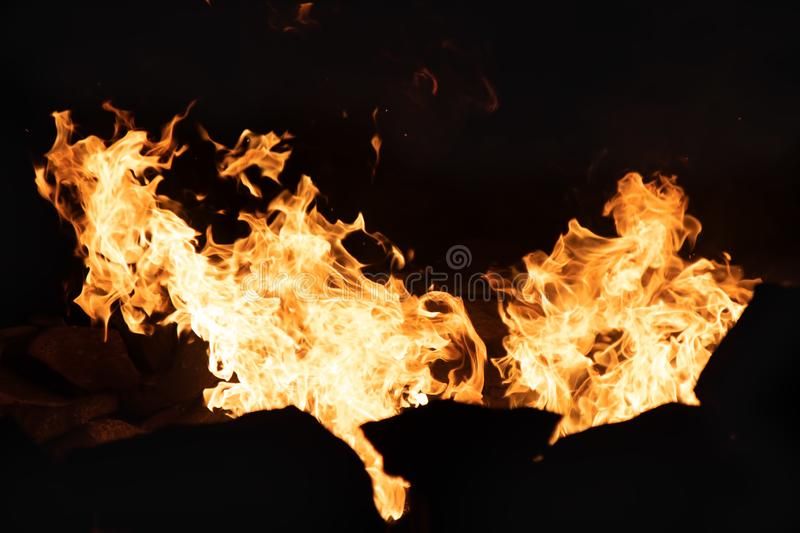 Fire in a Stone Firepit at Night. In Summer stock photography