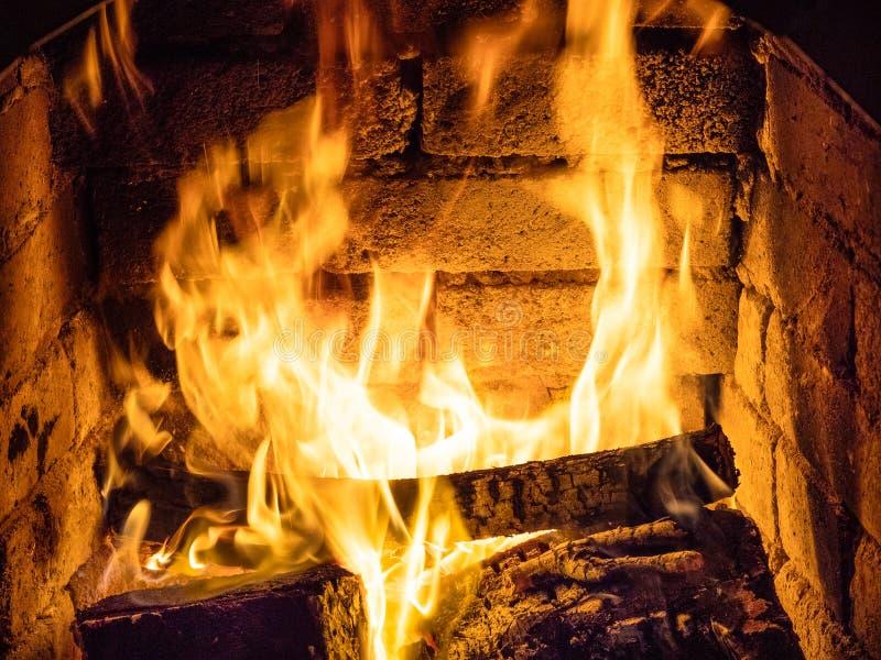 Fire in stone hearth stock photo