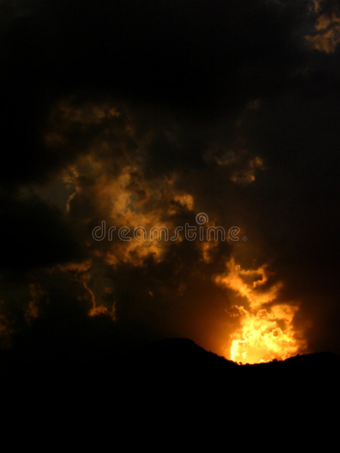 Fire @ Sunset. A sunset appears like volcanic fire in India royalty free stock photography